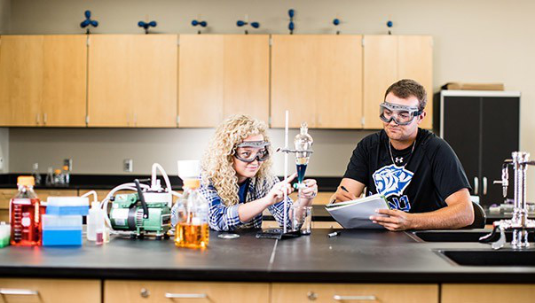 Two students in a science lab